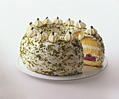 Crown cake with cream, cherries and chopped pistachios
