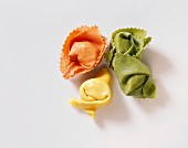 Green, yellow & red filled pasta tubes (like tortellini)