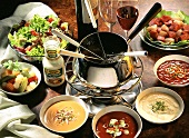 Fondue with boiling oil; meat cubes; sauces; mixed pickles