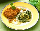 Pork escalope with cornflake crust and spinach