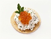 Cracker with cream cheese and caviare