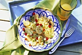 Potato salad with apple, pepper, herbs and lime zest