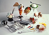 Several garnished ice cream sundaes, ice cream scoop & cutter