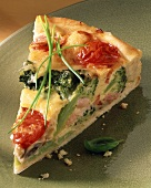 A piece of broccoli and tomato quiche with bacon
