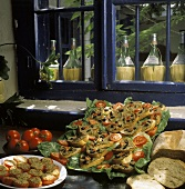Appetiser buffet with stuffed tomatoes & crostini