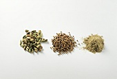 Cardamom capsules, coriander seeds and cardamom powder