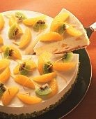 Orange cheesecake with orange segments & kiwi pieces
