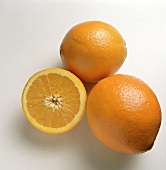 Two Oranges; One Sliced