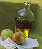 Two Apples with a Bottle of Apple Vinegar