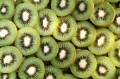 Several Kiwi Slices in a Pile