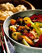 Chinese fried vegetables in bowls & yeast dumplings