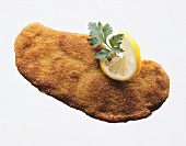 A Wiener Schnitzel with lemon slice and parsley