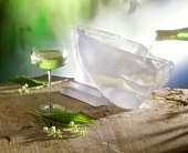 A glass of May wine & champagne is poured into a punchbowl
