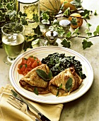 Saltimbocca (veal with ham, sage) with spinach & tomatoes