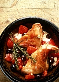Chicken thigh with tomatoes, olives, garlic, rosemary