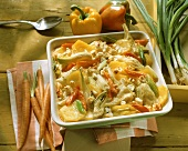 Summer vegetable casserole with sheep's cheese in square dish