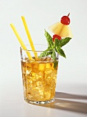 A glass of Mai Tai with yellow straw, mint