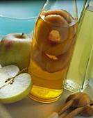 A Bottle of Apple Juice; Fresh Apples
