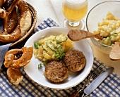 Bavarian burgers with potato and cucumber salad