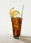 Cuba libre in tall glass with lemon slices and straw