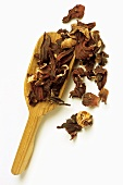 Wooden scoop with mallow flower tea (dried mallow flowers)