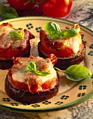 Baked aubergine slices with tomato, cheese, basil