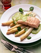 Salmon fillet on white asparagus with cress whip