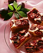 A few pieces of plum cake on glass plate