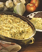 White cabbage gratin in a dish, décor: cabbage, garlic, apples