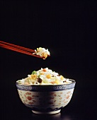Chinese rice bowl, rice on chopsticks and in bowl