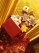 Christmas biscuits falling out of red gift box