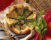 Herb soft cheese quiche with sorrel, pieces cut