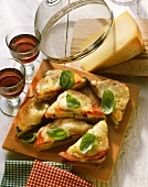 Tomato and courgette cheese toasts, decoration: red wine