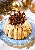 Mocha charlotte with cream & chocolate curls on Christmas plate