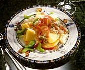Sauerkraut salad with potatoes, apples, celery and ham