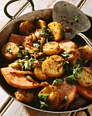 Pan-cooked sweet potato and ham dish with coriander