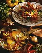 Fried potatoes with egg & salami; pepper & salami salad