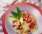 Tropical salad with palm hearts, carambola, tomatoes, avocado