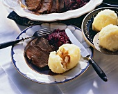 Roast beef with Thuringian dumplings & red cabbage on plate