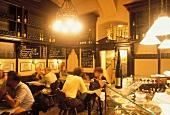 Guests in a bar in Vienna Wein Comptoir, Austria