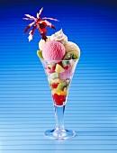 Ice cream sundae with fresh fruit and cream