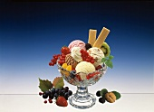 Ice cream sundae with fresh fruit, berries, cream & wafers