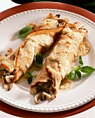 Crepe roll with mushroom filling & toasted cheese topping