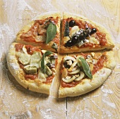 Pizza quattro stagioni: vegetables, ham, fish, mushrooms