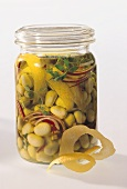 Pickled beans with onions and lemon peel in jar
