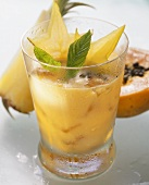 Papaya & pineapple drink, with carambola stars & mint