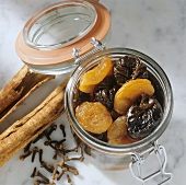 Bottled prunes and dried apricots in jar