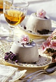 Turned-out yoghurt and lavender mousse on dessert plates