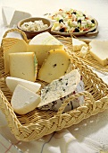 Assorted Cheese Pieces in a Basket