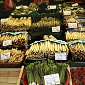 Market stall with many different types of asparagus